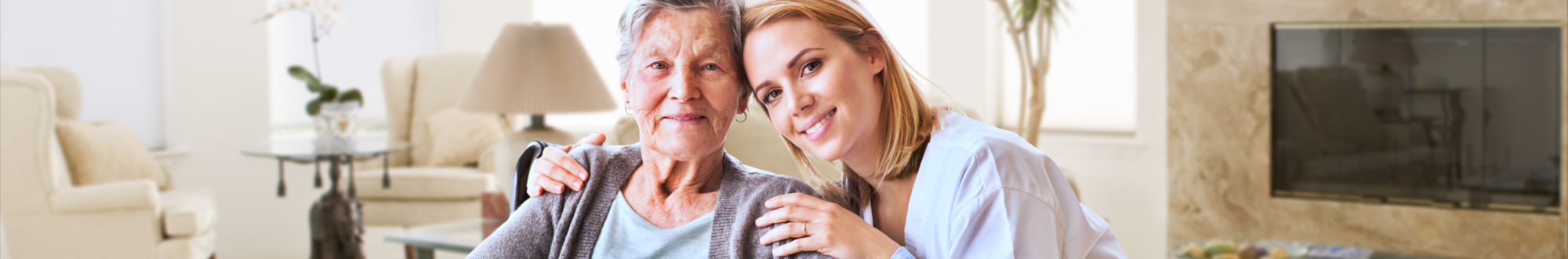 elderly woman and her caregiver