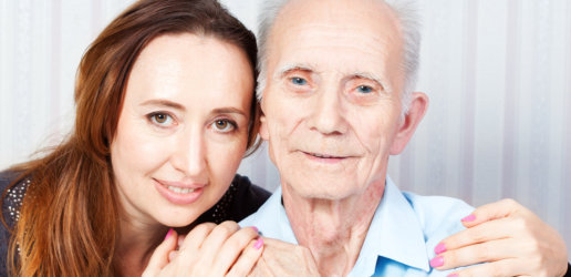 elderly man with his caregiver at home