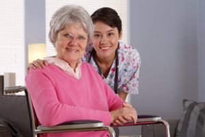 smiling caregiver and elderly woman